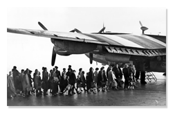 Refugees Boarding Plane in 1953